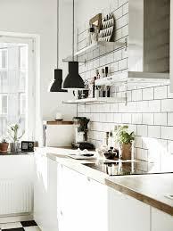 nordic kitchen stainless steel shelves and ikea hektar pendant lamps