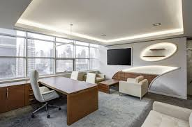 office design architecture. Gray Office Rolling Chair Near Brown Wooden Desk In Front Of Flat Screen Tv On White Design Architecture