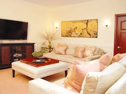 Stylish Oriental Themed Living Room Features Beautiful Artwork, Light Toned  Furniture And Entertainment Area (