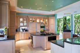 kitchens with white cabinets and blue walls. the shape of dark granite counters mimics octagonal island and creates kitchens with white cabinets blue walls