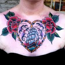 тату на женской груди тату под грудиной у девушек фото