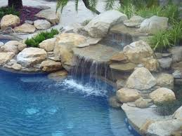 rock waterfall and pond into swimming pool contemporary swimming pool and hot