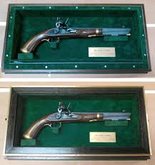 antique pistol shadowbox complete with brass plaque this particular firearm is a single shot flintlock pistol recently given to an officer by his unit