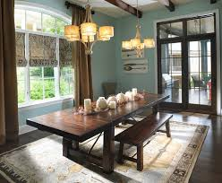 table decorations for fall with area rug also baseboard and wood beams benches dark hardwood floors roman shades plus chandelier traditional dining room