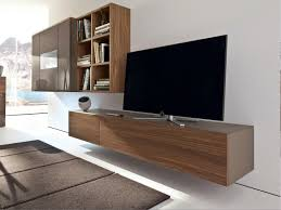 brown plywood veneer wall mounted tv cabinet attached on white painted wall captivating wall mount