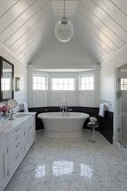 tongue and groove white. fantastic bathroom features tongue and groove, vaulted ceiling over upper walls painted white lower clad in black groove paneling c