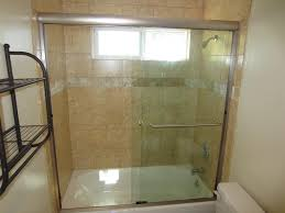 image of sliding shower doors over tub