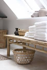 bathroom bench. white towels, basket and wood furniture - bathroom. bathroom bench