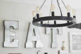 let there be light farmhouse flare designs shea bronze edison bulb 9 light