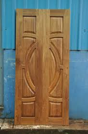Wooden door designing Panel Door Design Triangle Homez Kerala Door Designs Window Designs Latest Doors And Windows Desings