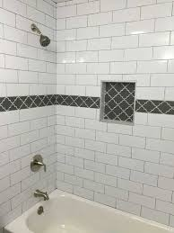 white subway tile with dark gray grout and gray fleur accent opinion from shower accent tile