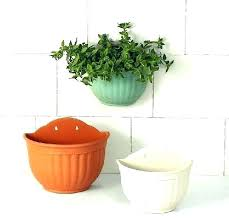 wall plant holder metal wall plant holder wall mounted plant holders plain color round plastic hanging