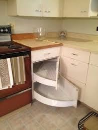 corner kitchen furniture. this is a great kitchen with unique idea for that corner cabinet space hard to use these large shelves swing out from the back furniture e