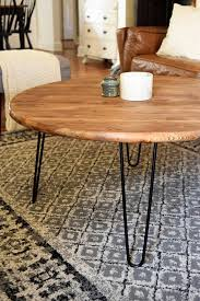 round wood coffee table with black