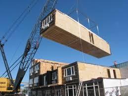 Crane installs modular building ...