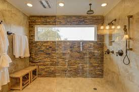 Large contemporary shower with slate and limestone with rainfall shower head