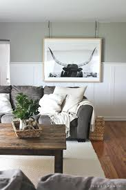instead of a gallery wall try large piece art that makes big living room artwork for