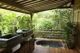 Bathroom:Neutral Round Stone Bathtub For Amazing Outdoor Bathroom Ideas  With Cream Gravel Field And