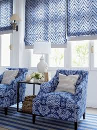beautiful patterned roller blinds in blue and white with coordinating chairs