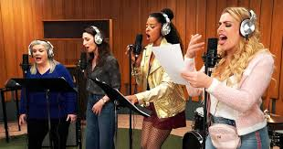 Musical definition, of, relating to, or producing music: Behind Girls5eva S Catchy Laugh Out Loud Fake Pop Songs