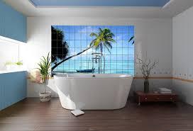 tile board bathroom home: bathroom tile board wall panel with beach image behind freestanding white soaking bathtub on laminate wood bathroom flooring in beach themed bathroom tile