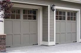 garage doors painted same color as the house blend in more