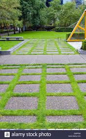 concrete grass pavers. Grass Growing Between Concrete Pavers In Public Parks Landscaping
