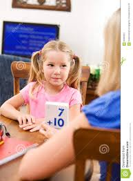 student mother helping child learn math flash cards stock student mother helping child learn math flash cards