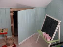 creative attic closet in the wall using standing chalkboard idea
