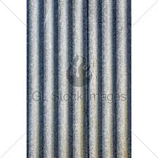 rusted metal sheeting with ripples for use as b