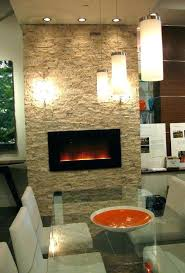 recessed wall electric fireplace mounted on stone surround with wood mant