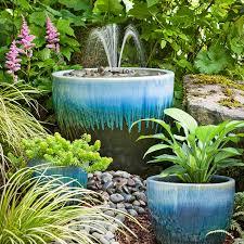fountain in a blue ceramic pot