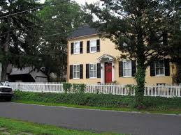 beautiful yellow house red door black shutters and we have light yellow siding really want to