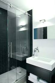 barn door shower aqua glass contemporary bathroom and black tile wall one handle faucet sliding parts