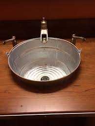 rustic sink made from galvanized bucket cool idea for a mud room sink