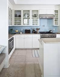 blue with white tile kitchen backsplash