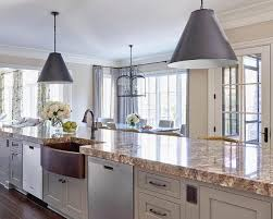 long gray kitchen island with gold countertops and copper a sink