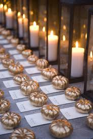 fall wedding place card holders. adorable gold pumpkins weigh down these place cards fall wedding card holders d