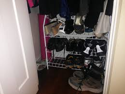 shoe rack with high heels and hiking boots