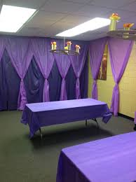 Decorating wall space with plastic table cloths. Has a nice gothic look to  it.