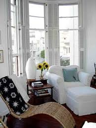 Wood shutters open flat to take advantage of the natural light and full  view afforded by Using Your Bay Window Space