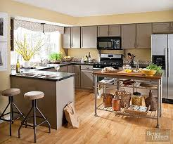 Kitchens are busy workplaces that benefit from peaceful-hue perimeters. In  this kitchen, buttery yellow paint (cued by the wood floor's golden  undertones) ...