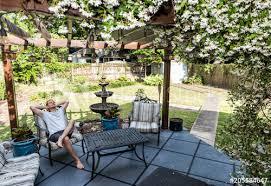 man lying down on patio lounge chair