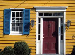 red door blue shutters yellow house by jody9