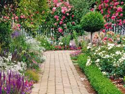Landscape design, flower garden: brick path through a double border