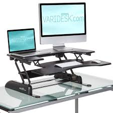 varidesk pro plus the varidesk pro plus adjule riser sits on top of your existing desk allowing you to switch from a seated to standing position