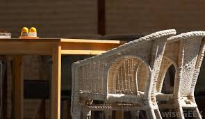 A wicker chair may use materials like straw of bamboo slats around a rattan  frame.