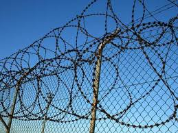 barbed wire fence prison. Razor Wire Fence Installed On Chain Link For Security Barbed Prison