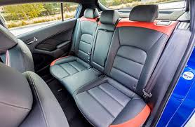 interior seating in the 2017 kia forte5 hatchback in gray and orange