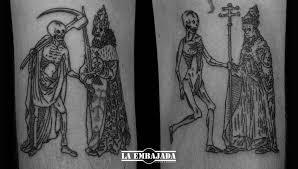 old book grabs tattoo by laembajadatattoo